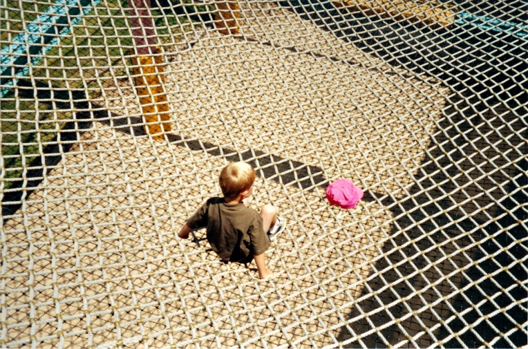 a boy, a hat, a net
